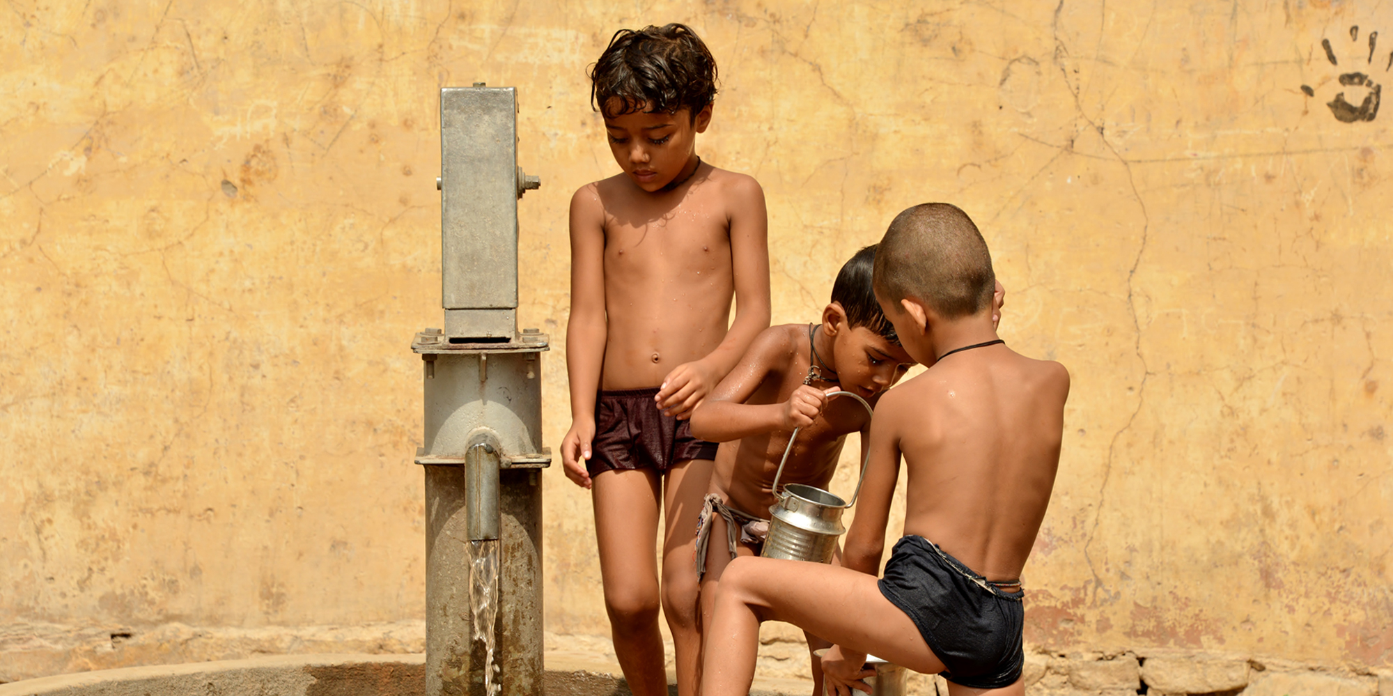 <strong>A Group Of Boys Take A Bath In A Communal Well, Jaipur</strong> -