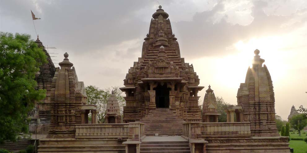<strong>Khajuraho Temple </strong> - Lakshmana temple at Khajuraho, a panchayatana temple. Two of the four secondary shrines can be seen.