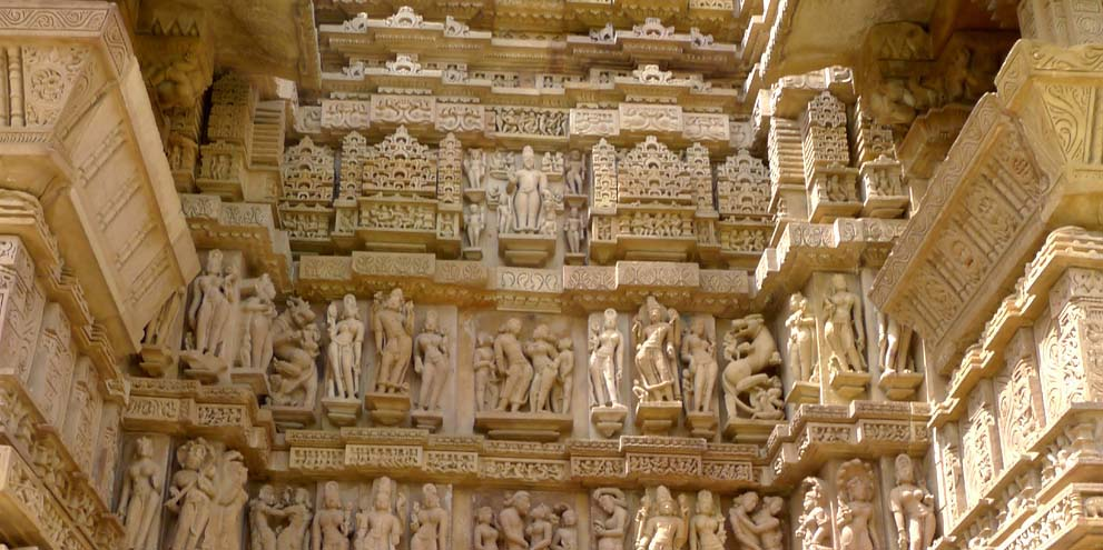 <strong>Khajuraho</strong> - A temple relief at Khajuraho in Madhya Pradesh, India features a couple in a sexual embrace with a man and a woman masturbating to either side.