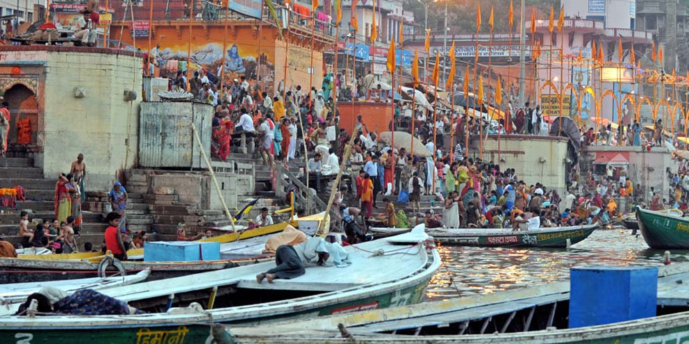 <strong>Varanasi</strong> - Sun sets as Hindus move into the waters of the Ganges for ritual bathing after the aarti ceremony here. Hindus believe that bathing in the Ganges remits sins and that dying in Kashi ensures release of a person's soul from the cycle of its transmigrations.