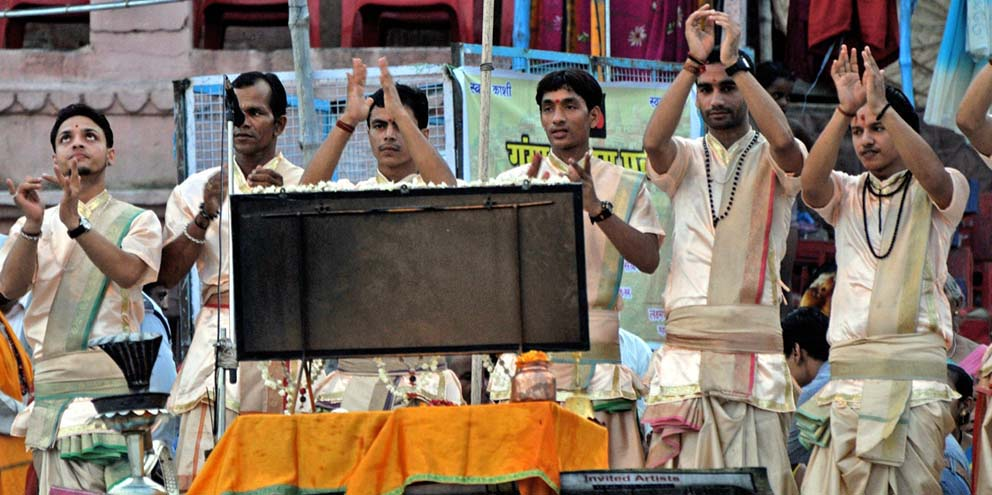 <strong>Varanasi</strong> - Hindu priests prepare for the aarti, a spiritual ritual of worship. During the aarti, light from wicks soaked in ghee or camphor is offered to one or more deities.