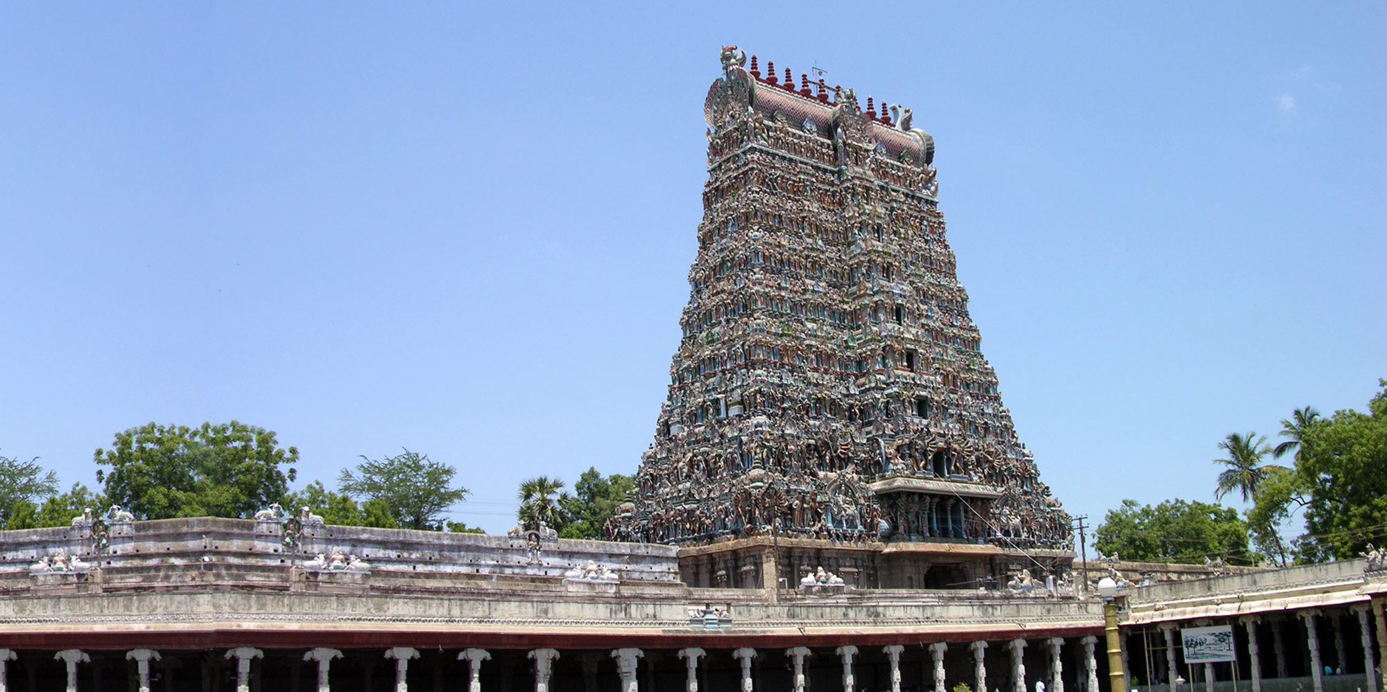 <strong>Meenakshi Temple - 1, Madurai</strong> - Pyramidal gates known as gopuras rise more than 160 feet (49 meters) into the air at the four cardinal points of the Sree Meenakshi Temple Complex. These towering gateways are entrances to the temple complex while shorter gopuras lead to the sanctums of the main dieties.