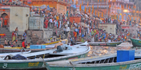 Ghat of Varanasi - 3, Varanasi - Sun sets as Hindus move into the waters of the Ganges for ritual bathing after the aarti ceremony here. Hindus believe that bathing in the Ganges remits sins and that dying in Kashi ensures release of a person's soul from the cycle of its transmigrations.
